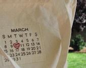 a custom calendar tote... choose your date