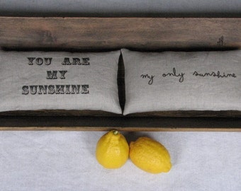 a secret message pillow pair... you are my sunshine/you make me happy