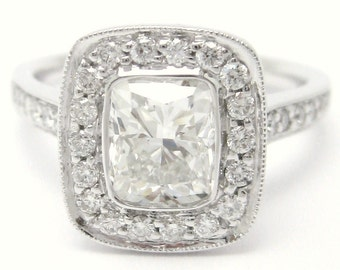 1.25ctw cushion cut bezel set diamond engagement ring in an antique designer inspired setting