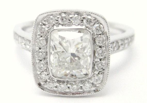 1.25ctw cushion cut bezel set diamond engagement ring in an antique designer inspired setting