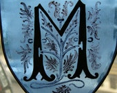 Marvelous 'M', stained-glass suncatcher