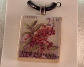 Scrabble tile pendant with free black leather cord-vintage New Zealand Stamp
