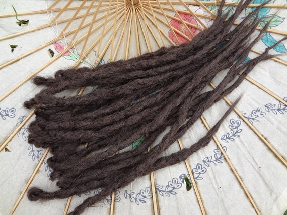 Milk Chocolate Medium Brown knotty dreadlock extensions. 13 single ended dreads.