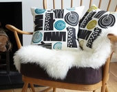 New colourway - Log pile cushion in charcoal on white linen