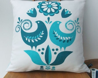 Happy birds cushion in teal on white linen