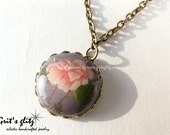 Peony pendant coated with resin in vintage lace setting