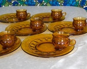 6 Amber Glass snack sets with plate and teacup,  Kings Crown Thumbprint