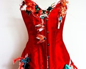 SHE WAS A LITTLE CHINA DOLL BUT HER TEMPER WAS HOT AS CHILLI -METAL BONED CORSET IN ORIENTAL RED. SHOWGIRL EMBELLISHED,HIGHLY ORNATE INCLUDING GENUINE POST WWII SUSPENDER CLIP WITH FACETED SEMI PRECIOUS STONES. OLD HOLLYWOOD STYLE-OOAK.