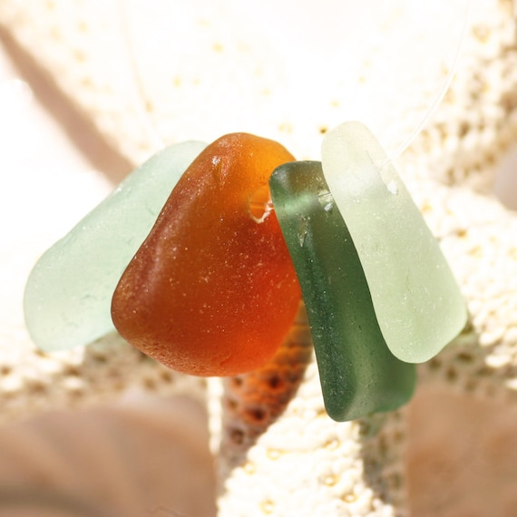 Top drilled Seaglass in Mixed Colors. 4 Pieces. Rich Aqua, Seafoam, Teal and Brown. Charm Sized.