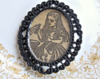Alice in Wonderland Brooch Pin. Drink Me Vintage Black Illustration. Cameo Noir Two Cheeky Monkeys. Bouquet Jewellery Jewelry Accessories