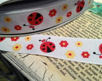 "7/8"" Red and Yellow Lady Bug Themed on White Grosgrain Ribbon sold by the yard"