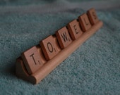 Scrabble word for bath or laundry (TOWELS)