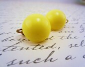 Vintage yellow clip on earring. Bright color. Large dot. Stud earring. Pretty sunshiny pop of color. Sunny, sunshine.