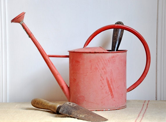 rustic red watering can