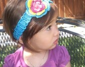 Olivia Headband in Turquoise with yellow, magenta and pink flower
