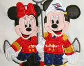 Mister and Miss Mouse dressed in their cruise wear on anchor appliqued in 3d holigraphic material on a short sleeved tee