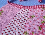 Quilted Baby Bib in pink
