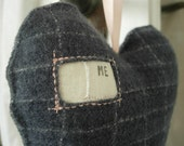 Handwoven 'me heart you' grey wool heart.