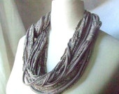 African dream necklace/scarf - cotton strips necklace in soft brown and printed brown and black colors.