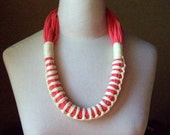 Zulu, necklace  -  elastic cotton necklace in salmon and yellow colors.