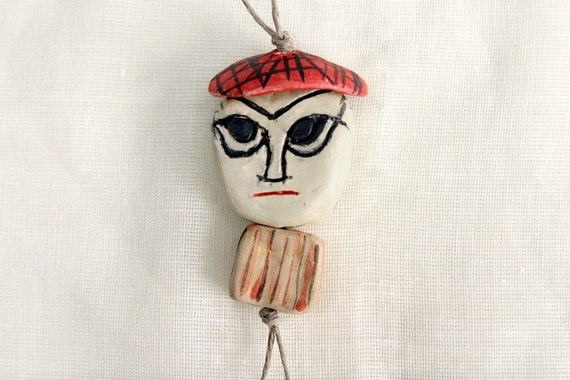 Blunne -------- Ceramic Miniature on String--Holiday gift--can be part of a moblie