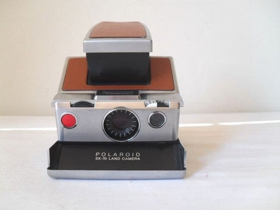 Vintage Polaroid SX 70 Camera with Tons of extras