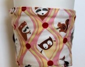 Happy Forest Family Reversible Coffee Cozy by Uptown Avenue