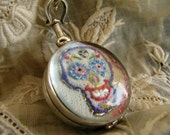 Hand Embroidered  Art Piece in a Two Sided Glass Locket , Sterling Silver Mounted Pendant