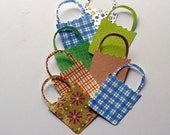 Group of gift bag die cuts in assorted colors