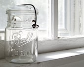 Farmhouse Secure, a clear Ball pint lightning jar with glass lid and wire clamp