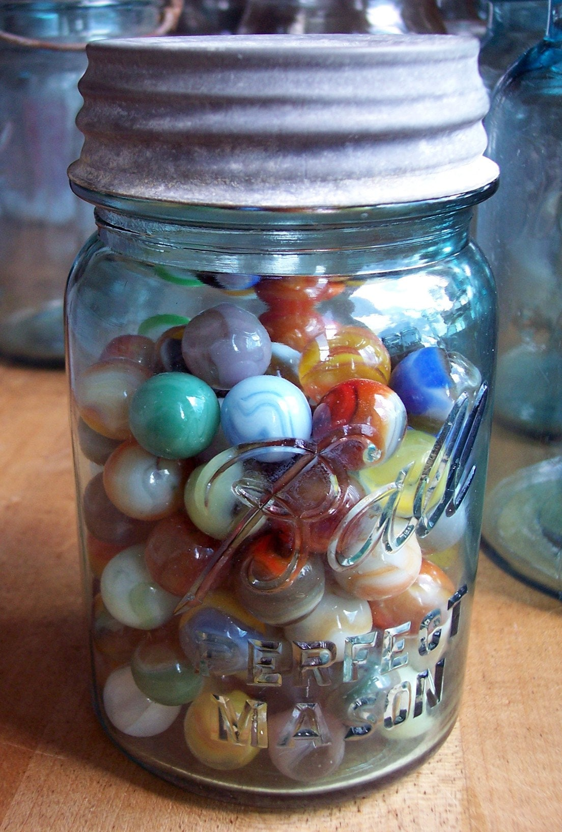 Marbles In A Blue Pint Ball Jar With A Zinc Lid