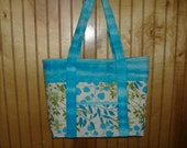 Cream turquoise green leaf pattern quilted with two tone turquoise batik trim