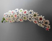 Vintage flower shaped white enameled brooch with multi colored rhinestone centers in great condition