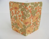 Mini Notebook covered in floral poppy paper. Compare to moleskine notebooks