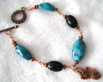Turquoise, blackstone, and copper bracelet