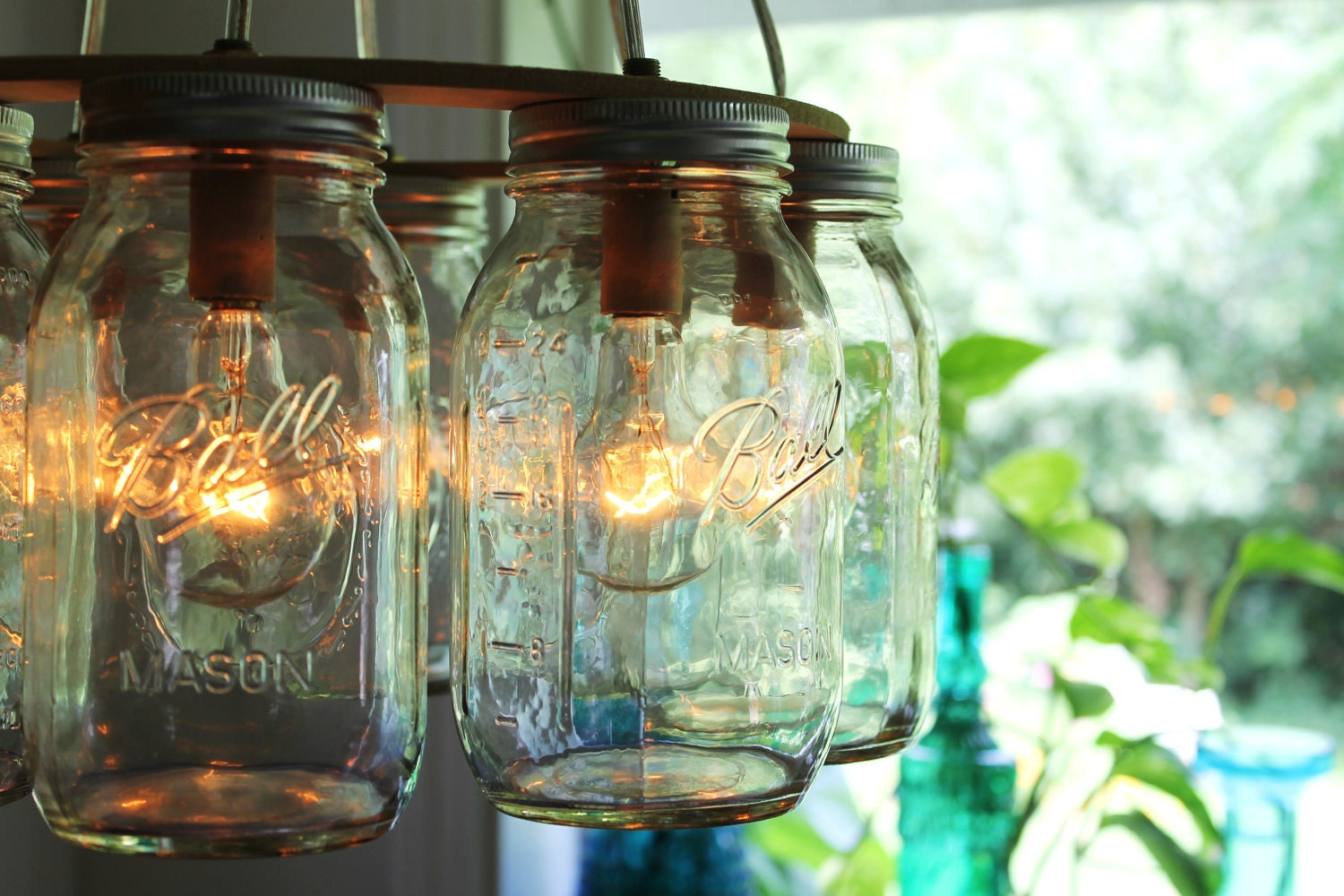Mason jar chandelier mason jar light wagon wheel by bootsngus for Hanging lights made from mason jars