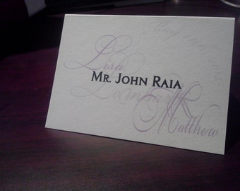 Monogram Escort/Place Card with guests names on top of the monogram