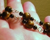 Tiger Eye, Black Onyx and Silver Bracelet by TriannasTreasures