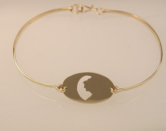 Old Man in the Mountain cut out gold bracelet