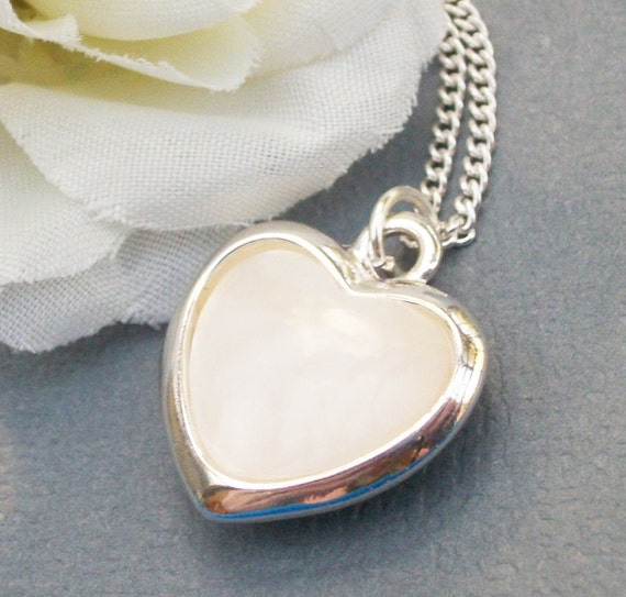 Mother Of Peal Heart On A Silver Chain.