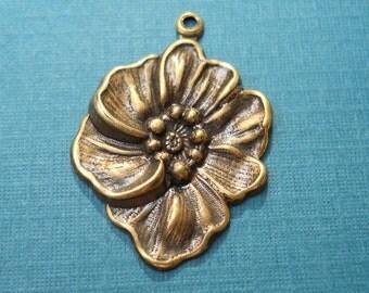 Victorian   flower charm in antique brass Item 1830