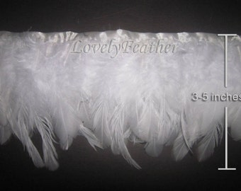 Coque feather fringe of white color 2 yards trim
