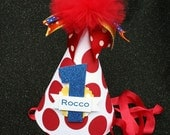 Little Dude birthday party hat in big red polka dot with blue yellow and orange