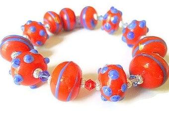 Lampwork beaded bracelet hot orange  blue swarovski elements stretch autumn fall jewelry