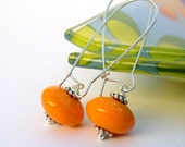 Orange elongated lampwork earrings Hop on the Rainbow