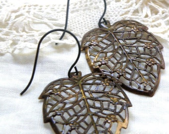 Oxidized brass filigree leaves, detailed filligree, stylized leaves, oxidized brass leaves