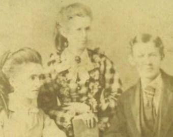 Antique 1880s Studio Portrait Women Man Sitting At Table Books Victorian Dress Gowns Corset Bustle Hair Curls Photo Photograph