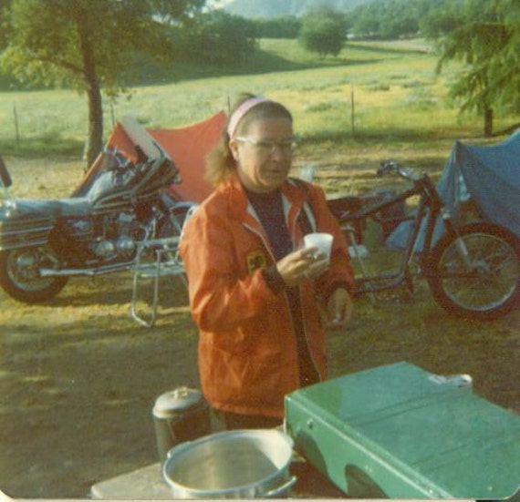 Motorcycle Chopper Tent Camping Road Trip Vintage 1970s Color Photo Biker Woman CA Mountains Bikes Tents Orange Jacket Morning Coffee