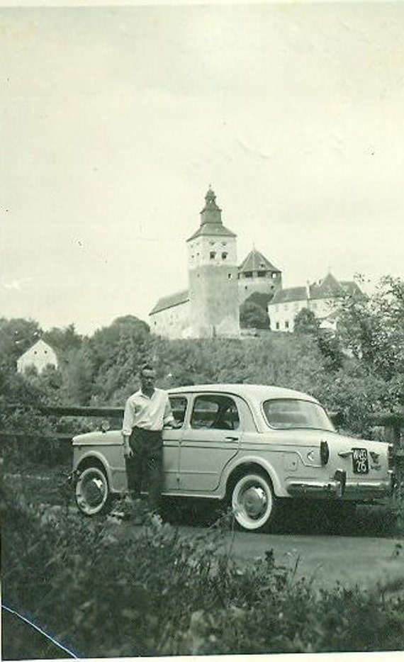 Vintage 1950s European Vacation Man Standing Next to Classic Car in front of Historic Castle England British Photo Snapshot Summer