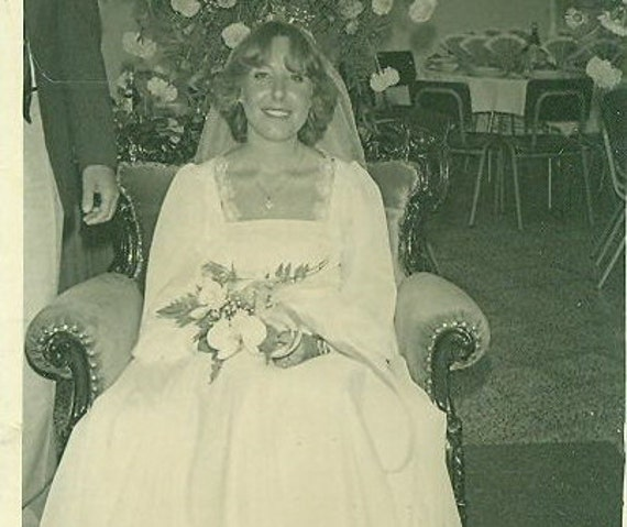 Vintage 1960s Wedding Photo Bride Sitting In Plush Chair Reception Flowers White Gown 60s 70s Hippie Photograph